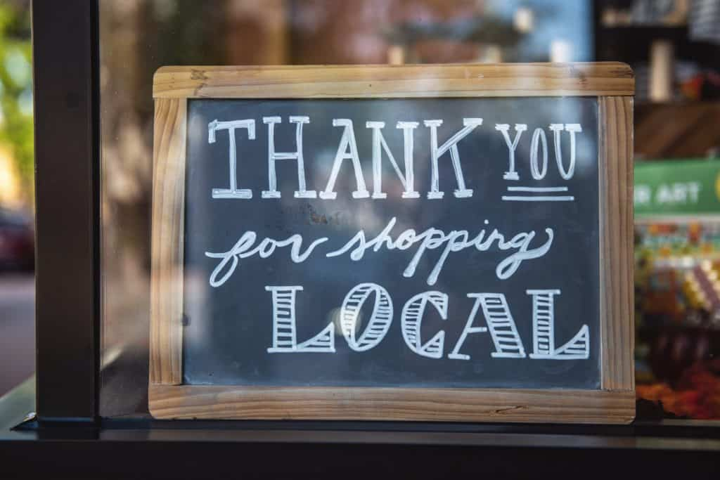 """Thank you for shopping local"" sign"
