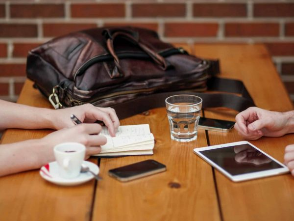Business meeting with two people sitting in front of each other while discussing something